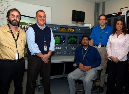 In addition to Phil Meek, other members of the cross-collaboration team include Scott Williamson, John Schneider, Saravana Chinnasamy, Tim Fannin and Heidi Kidder, pictured here with the 737 MAX Display System simulation rig in Cedar Rapids, Iowa.